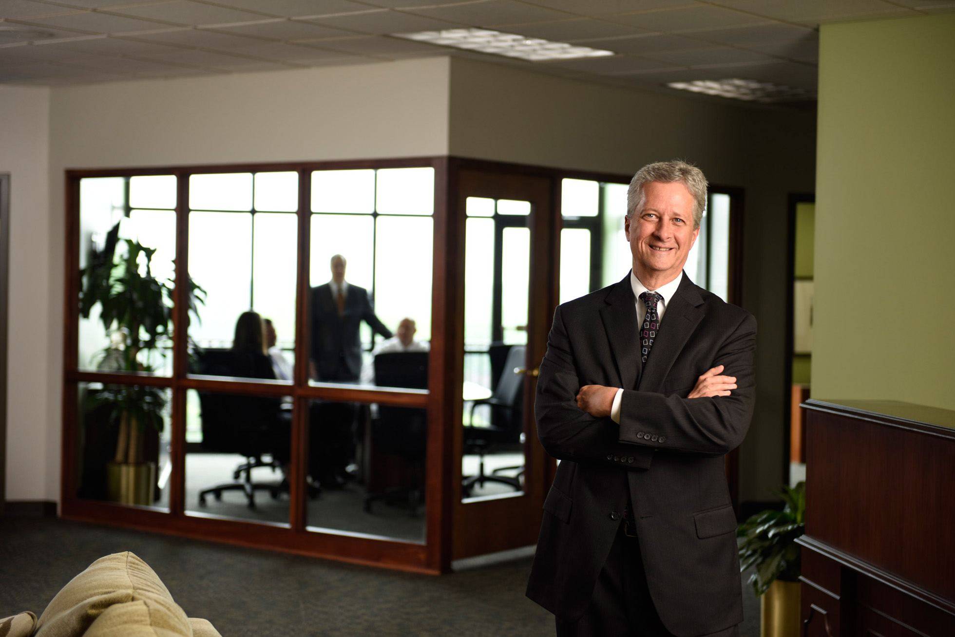 Image of man standing outside meeting room