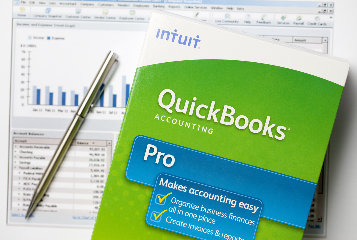 San Marcos, USA - July 5, 2011: QuickBooks box on graphs. Quickbooks is an accounting software program created by INTUIT corporation. It is the most popular accounting software program for small business with over 90% market share.